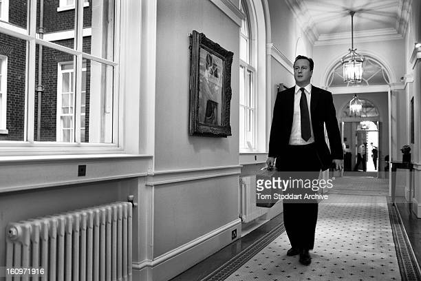 British Prime Minister David Cameron photographed walking towards his office inside 10 Downing Street hours after returning from the Commonwealth...