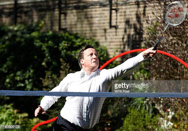 British Prime Minister David Cameron plays a game of badminton with school athletes and London 2012 Organising Committee chairman Sebastian Coe in...