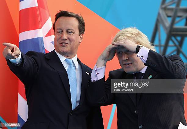 British Prime minister David Cameron points as London Mayor Boris Johnson looks on attends the' London 2012 One Year To Go' ceremony in Trafalgar...