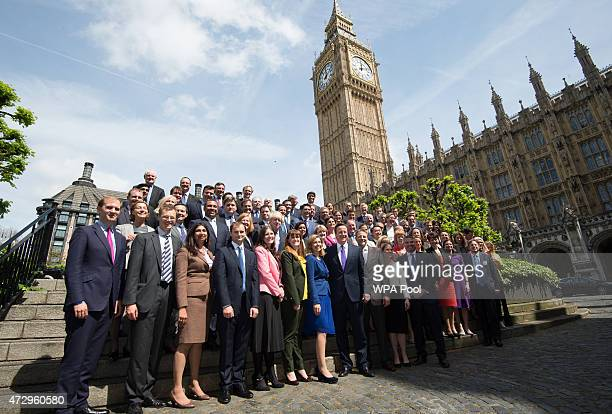 British Prime Minister David Cameron poses for a photo with the newly elected Conservative Party MPs in Palace Yard on May 11 2015 in London England...