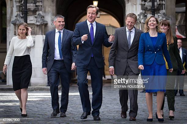 British Prime Minister David Cameron poses for a photograph with newlyelected Conservative party members of parliament MP for Twickenham Tania...