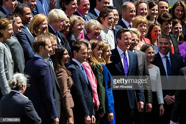 British Prime Minister David Cameron poses for a picture with the new Conservative Party MPs in Palace Yard on May 11 2015 in London England Prime...