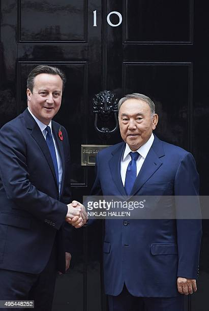British Prime Minister David Cameron poses for pictures with President Nursultan Nazarbayev of Kazakhstan outside 10 Downing Street in London on...