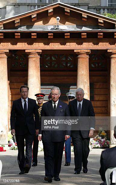 British Prime Minister David Cameron Prince Charles Prince of Wales and US Ambassador Louis Susman attend the tenth anniversary ceremony of victims...