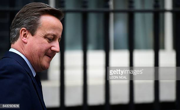 British Prime Minister David Cameron reacts as he departs 10 Downing Street enroute to the Houses of Parliament in central London on June 27 2016 The...