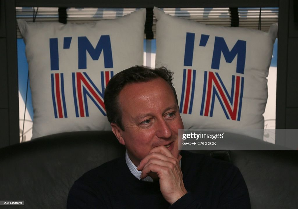 British Prime Minister David Cameron reacts as he travels on his campaign us from Bristol, south-west England, on June 22, 2016, as the prime minister campaigns to avoid a Brexit ahead of the June 23 EU referendum. Rival sides threw their efforts into the final day of campaigning Wednesday, on the eve of Britain's vote on EU membership that will shape the future of Europe. / AFP / POOL / Geoff CADDICK