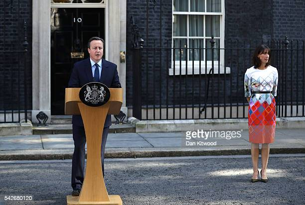 British Prime Minister David Cameron resigns on the steps of 10 Downing Street his wife Samantha Cameron listens on June 24 2016 in London England...