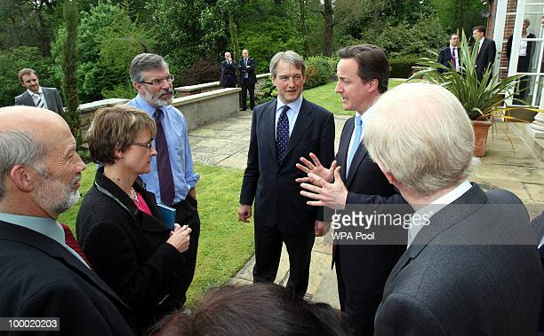 British Prime Minister David Cameron Secretary of State for Northern Ireland Owen Paterson and Sinn Fein President Gerry Adams are seen at Stormont...