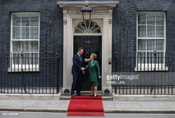 British Prime Minister David Cameron shakes hands as he greets Chilean President Michelle Bachelet on the steps of 10 Downing Street in central...