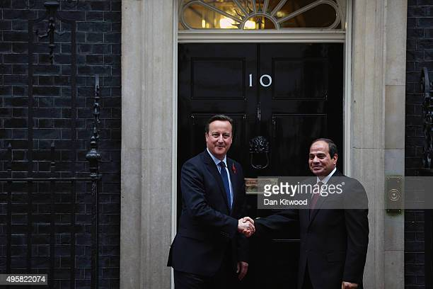 British Prime Minister David Cameron shakes hands with Egyptian President Abdel Fattah alSisi at 10 Downing Street on November 5 2015 in London...