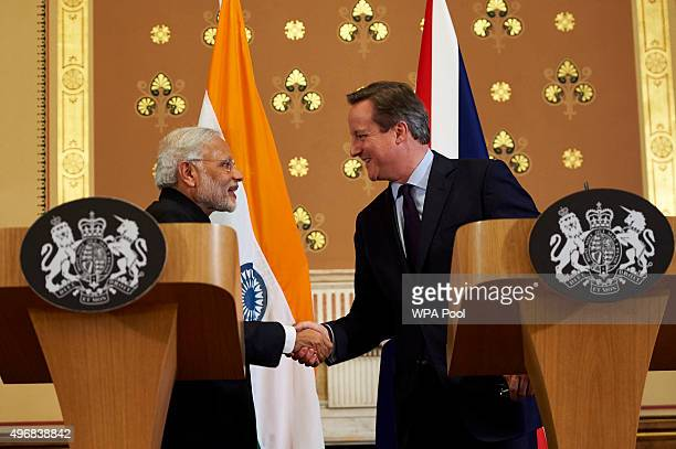 British Prime Minister David Cameron shakes hands with India's Prime Minister Narendra Modi after a joint press conference at the Foreign Office...