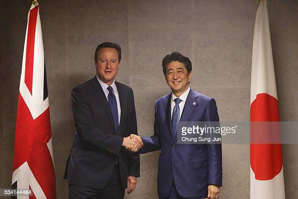 British Prime Minister David Cameron shakes hands with Japanese Prime Minister Shinzo Abe during a bilateral meeting on May 25 2016 in Shima Japan...