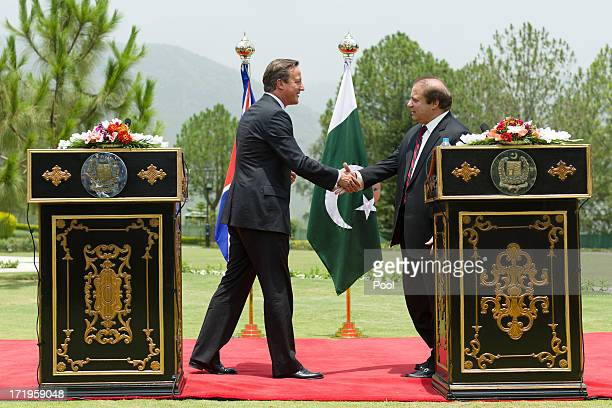 British Prime Minister David Cameron shakes hands with Pakistani Prime Minister Nawaz Sharif during a press conference at the Prime Minister's house...
