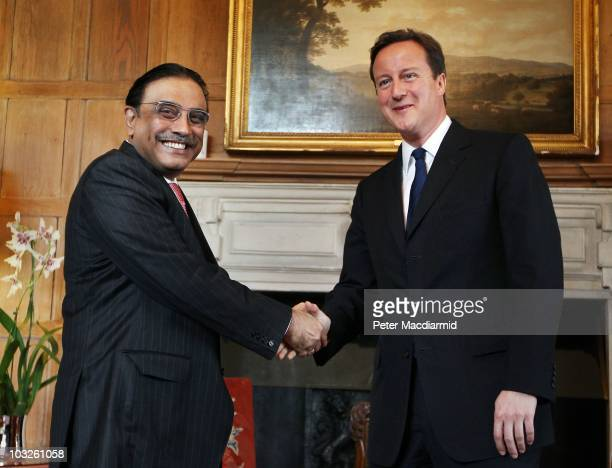 British Prime Minister David Cameron shakes hands with Pakistan's President Asif Ali Zardari on August 6, 2010 at Chequers near Princes Risborough,...