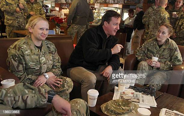 British Prime Minister David Cameron shares a warm drink at a Navy, Army and Air Force Institutes facility with British soldiers at Kandahar airfield...