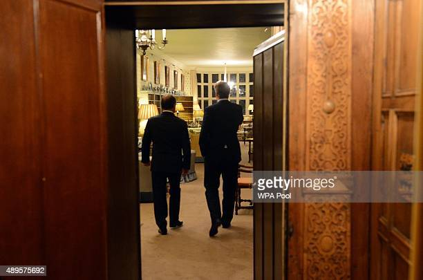 British Prime Minister David Cameron shows French President Francois Hollande the Great Room at Chequers during a bilateral meeting and a working...