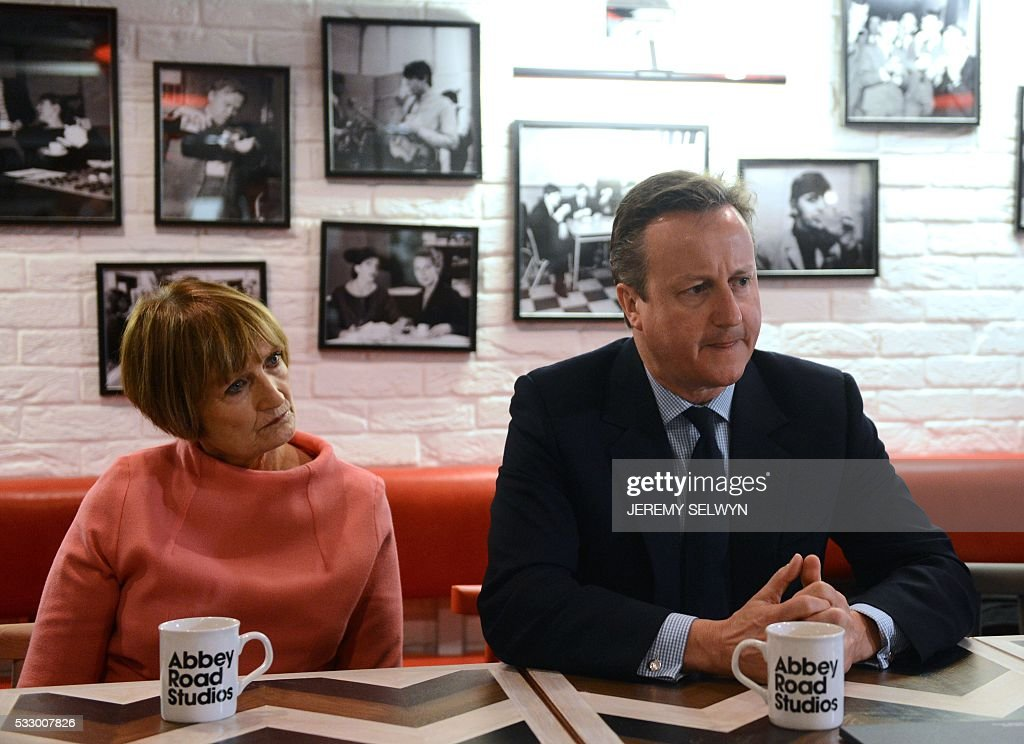 British Prime Minister David Cameron (R) sits with British Labour Party politician Tessa Jowell (L) while on a visit to Abbey Road studios in London on May 20, 2016. / AFP / POOL / Jeremy Selwyn