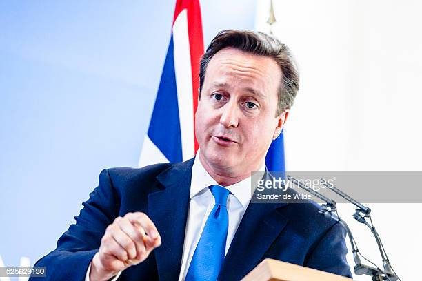 British Prime Minister David Cameron speaking with his finger pointing during a media conference at an EU summit in Brussels on Friday Oct 19 2012...