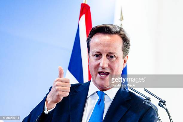 British Prime Minister David Cameron speaking with his thumb up during a media conference at an EU summit in Brussels on Friday Oct 19 2012 European...