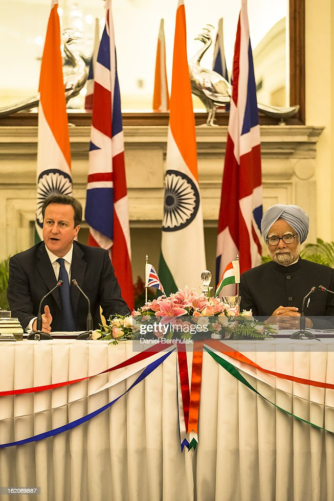British Prime Minister David Cameron speaks as Indian Prime Minister Manmohan Singh looks on during a press conference at Hyderabad House on February 19, 2013 in New Delhi, India. British Prime Minister David Cameron arrived in India on Monday for an official three-day trip accompanied by a large business delegation from the UK.