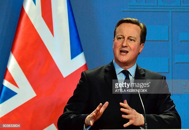 British Prime Minister David Cameron speaks at a press conference as he meets with his Hungarian counterpart in the Parliament building in Budapest...