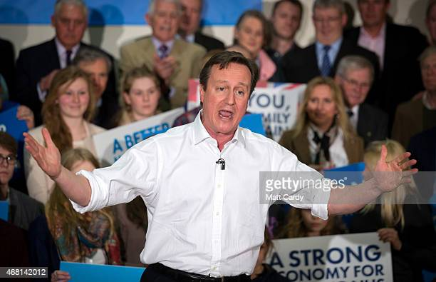 British Prime Minister David Cameron speaks at a rally to mark the start of the general election campaign at Corsham School in Wiltshire on March 30...