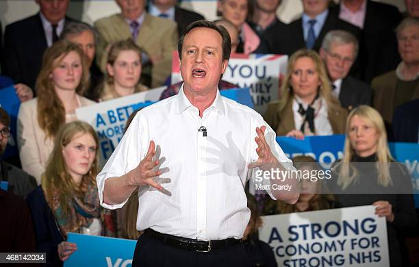 British Prime Minister David Cameron speaks at a rally to mark the start of the general election campaign at Corsham School in Wiltshire on March 30,...