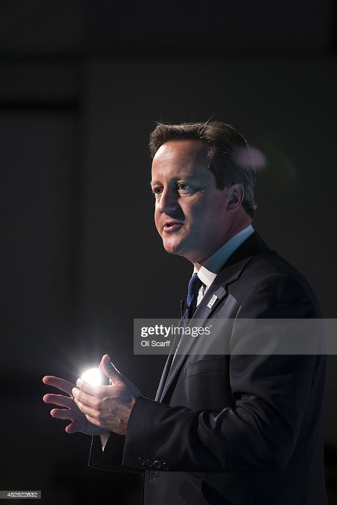 British Prime Minister David Cameron speaks at the 'Girl Summit 2014' in Walworth Academy on July 22, 2014 in London, England. At the one-day summit the government has announced that parents will face prosecution if they fail to prevent their daughters suffering female genital mutilation (FGM).