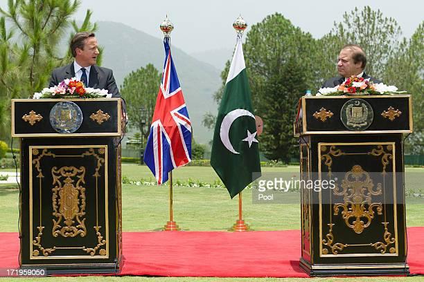 British Prime Minister David Cameron speaks beside Pakistani Prime Minister Nawaz Sharif during a press conference at the Prime Minister's house on...