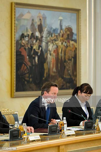 British Prime Minister David Cameron speaks during trade talks with Kazakhstan President Nursultan Nazarbayev at the Presidential Palace on July 1...