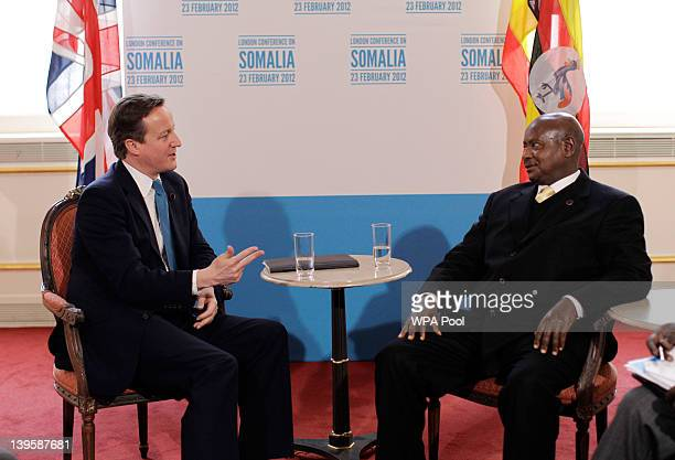 British Prime Minister David Cameron speaks in a bilateral meeting with Uganda's President Yoweri Museveni during the Somalia Conference at Lancaster...