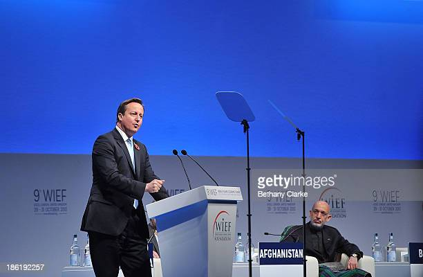 British Prime Minister David Cameron speaks on stage watched by HE Hamid Karzai President of the Islamic Republic of Afghanistan during the Leaders...
