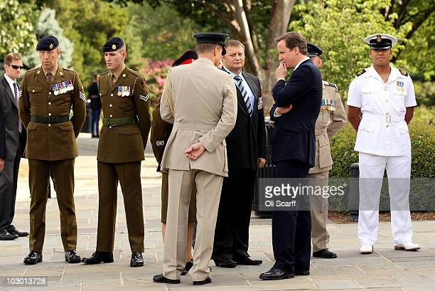 British Prime Minister David Cameron speaks to British people who have served in Afghanistan after he placed a wreath at the 'Tomb of the Unknowns'...