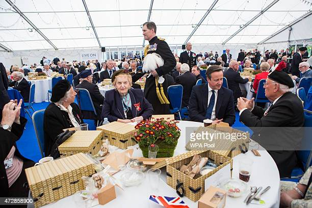 British Prime Minister David Cameron speaks to Edward Bullock RAF veteran of World War II the Royal British Legion Marquee in St James' Park as part...