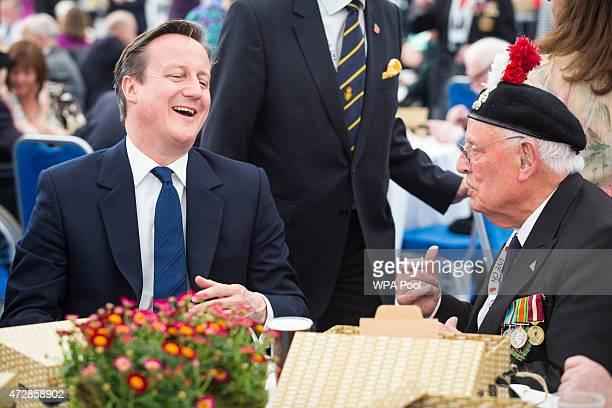 British Prime Minister David Cameron speaks to Edward Bullock RAF veteran of World War II the Royal British Legion Marquee in St James' Park as part...