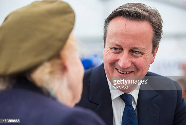 British Prime Minister David Cameron speaks to speaks to Helen Taylor Thompson a First Aid Nursing Yeomanry veteran of World War II the Royal British...