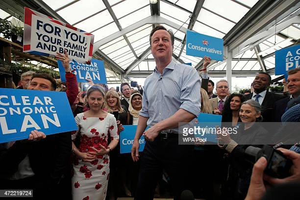 British Prime Minister David Cameron speaks to supporters during an election rally at Squires garden centre on May 5 2015 in Twickenham London...