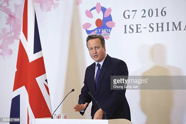 British Prime Minister David Cameron speaks to the media during a press conference on May 27 2016 in Ise Japan In the twoday summit the G7 leaders...