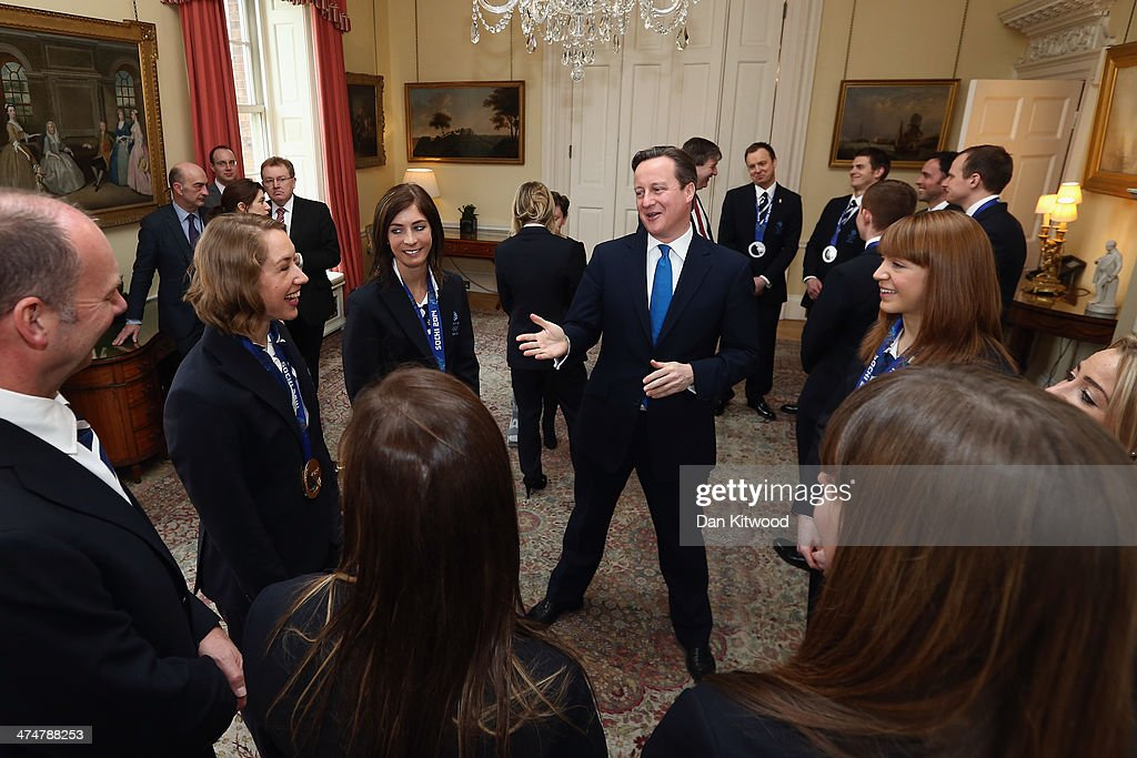 British Prime Minister David Cameron speaks with members of the Winter Olympic medal winning team at 10 Downing Street on February 25, 2014 in London, England. The Winter Olympic medal winners visited Downing Street today and met with the Prime Minister.