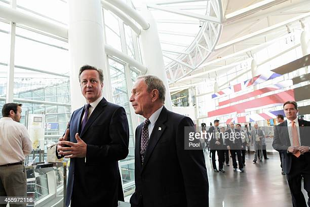 British Prime Minister David Cameron speaks with Michael 'Mike' Bloomberg founder of Bloomberg LP at Bloomberg LP headquarters on September 23 2014...
