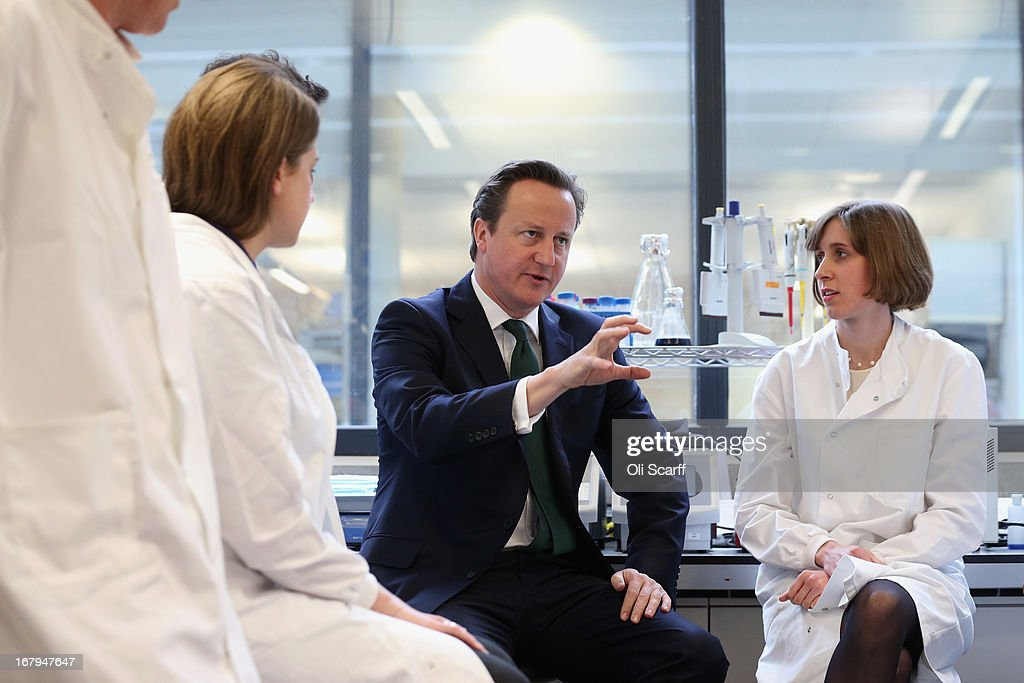 British Prime Minister David Cameron (C) speaks with scientists before opening the 'Li Ka Shing Centre for Health Information and Discovery' at Oxford University on May 3, 2013 in Oxford, England. Mr Cameron was joined by Mr Li and the Chancellor of the University of Oxford, Lord Patten, to launch a 90 million GBP initiative in 'big data' processing and drug discovery.