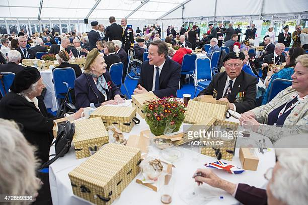 British Prime Minister David Cameron speaks WWII veterans in London on May 10 during an event to mark the 70th anniversary of the Victory in Europe...