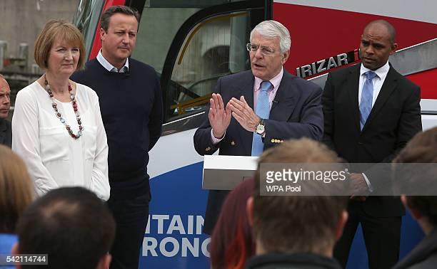 British Prime Minister David Cameron stands with Labour MP Harriet Harman as former Conservative Prime Minister John Major addresses proEU 'Vote...