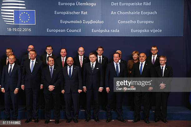 British Prime Minister David Cameron stands with other European Union leaders while attending a group photo at the Council of the European Union on...