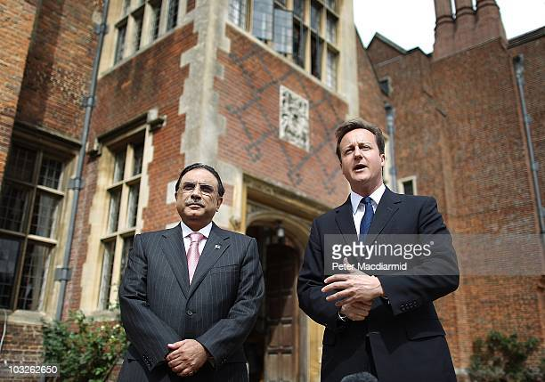 British Prime Minister David Cameron stands with Pakistan's President Asif Ali Zardari as they talk to reporters on August 6, 2010 at Chequers near...