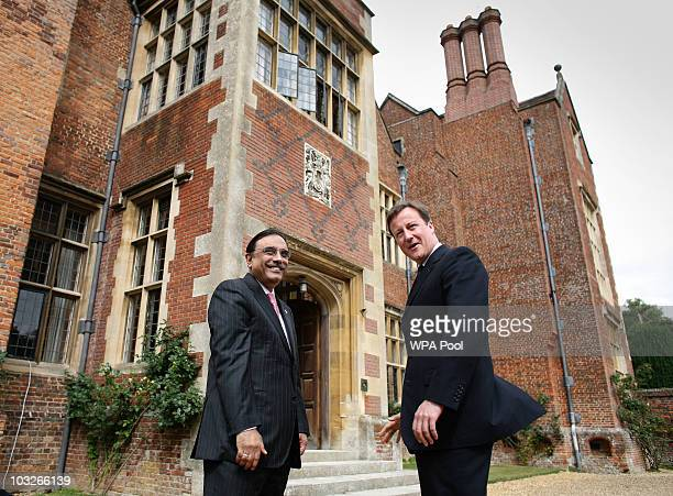 British Prime Minister David Cameron stands with Pakistan's President Asif Ali Zardari on August 6 2010 at Chequers near Princes Risborough England...