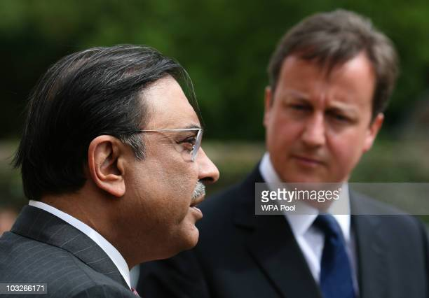 British Prime Minister David Cameron stands with Pakistan's President Asif Ali Zardari as they talk to the media on August 6, 2010 at Chequers near...