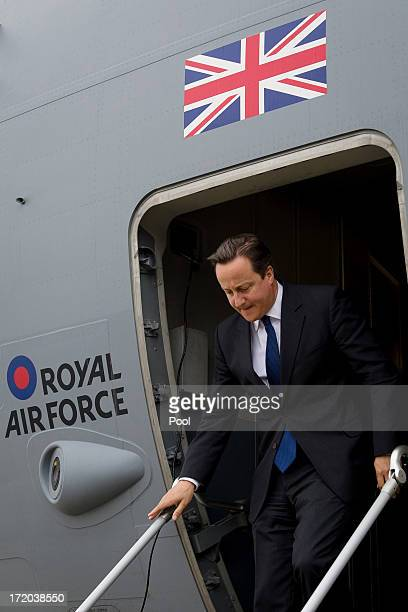 British Prime Minister David Cameron steps down from a C17 Globemaster RAF transport plane after landing at Atyrau airport on July 1 2013 in Atyrau...