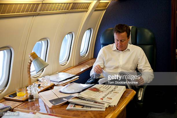 British Prime Minister David Cameron studies his notes during an RAF flight taking him and his team over Europe to attend the G20 Summit in Cannes...