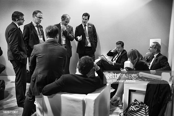 British Prime Minister David Cameron surrounded by his staff and advisors discuss tactics in the delegation office on the second day of the G20 Summit